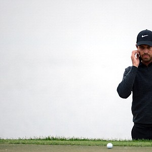 Charl Schwartzel ponders a putt on the 18th hole during the second round of the Honda Classic on March 1.