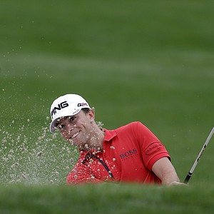 Luke Guthrie hits out of a bunker on the ninth hole during the second round of the Honda Classic.