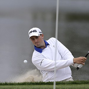 Michael Thompson hits out of a bunker toward the pin on the 18th hole during the second round of the Honda Classic on March 1.