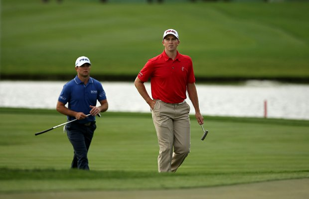 Michael Thompson and Luke Guthrie walk up No. 8 during the Honda Classic on Saturday.