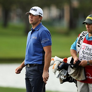 Luke Guthrie, left, with his caddie/brother, Zach, during the Honda Classic on Saturday.