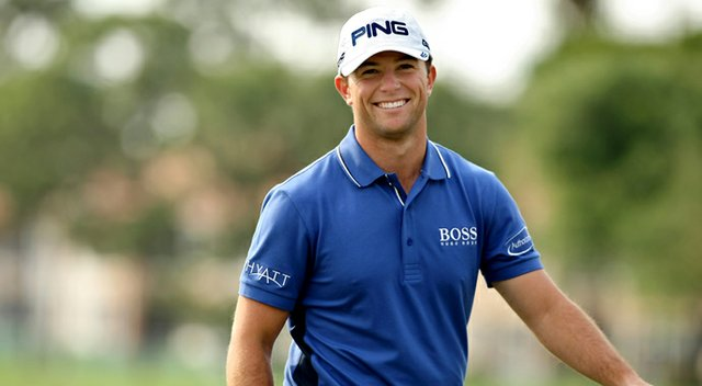 Luke Guthrie is all smiles after a birdie putt at No. 8 during the Honda Classic on Saturday.