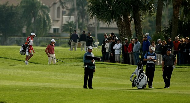 Billy Horschel rakes out his own bunker at No. 18 during the Honda Classic on Saturday.