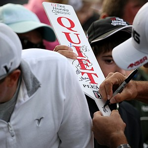 """Billy Horschel autographs a """"Quiet"""" paddle after his round on Saturday."""