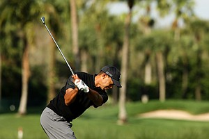 Tiger Woods hits his tee shot at No. 7 during the Honda Classic on Saturday.