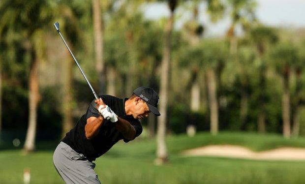 Tiger Woods hits his tee shot at No. 7 during the Honda Classic on Saturday.