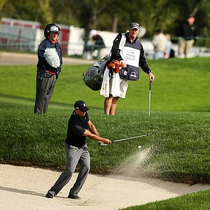 Tiger Woods hits out of the bunker at No. 9 during the Honda Classic on Saturday.