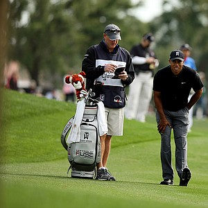 Tiger Woods stretches at No. 10 during the Honda Classic on Saturday.
