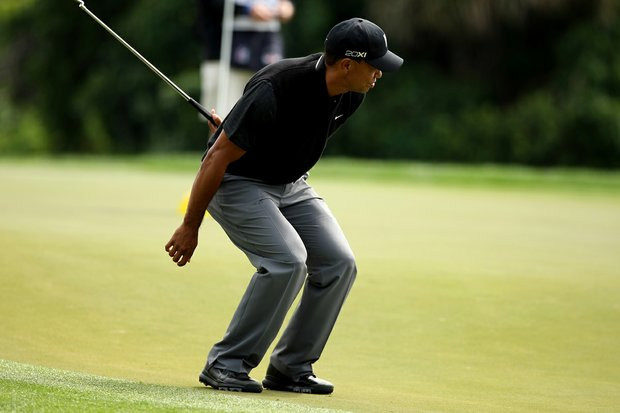 Tiger Woods reacts to missing his putt at No. 15 during the Honda Classic on Saturday.