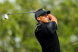 Tiger Woods watches his shot closely at No. 17 during the Honda Classic on Saturday. He made double bogey.