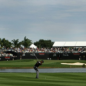 Tiger Woods hits his second shot at No. 16 during the Honda Classic on Saturday.