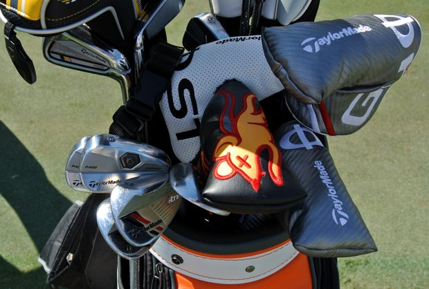 Justin Rose, who spent a lot of time on the practice green Tuesday, stuffed four different putters in his bag.