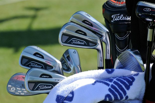 Tucked behind his Titleist 712AP2 irons, Jason Dufner's Vokey Design SM4 wedge is covered with stamped DUFs.