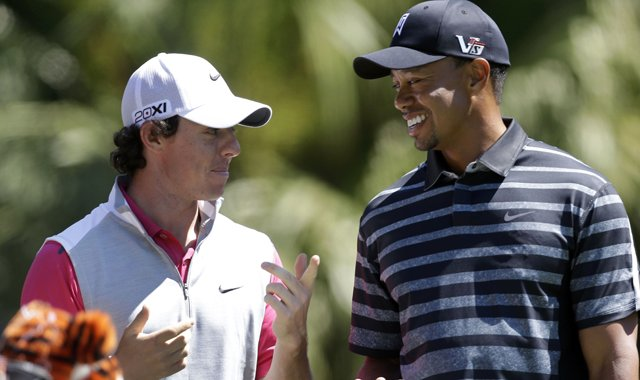 Rory McIlroy, left, and Tiger Woods wait on the No. 13 tee Thursday at the WGC-Cadillac Golf Championship in Doral, Fla.