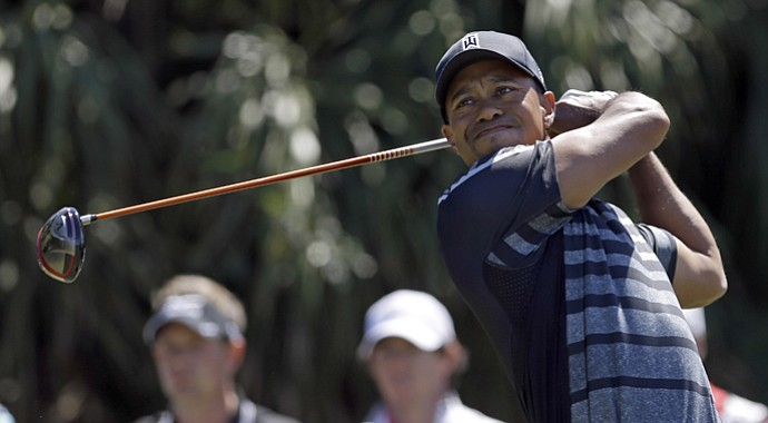 Tiger Woods tees off at No. 12 during Thursday's first round of the WGC-Cadillac Championship in Doral, Fla.