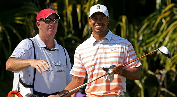 Tiger Woods and caddy Joe LaCava talk about his tee shot on the sixth hole during the second round of the WGC-Cadillac Championship.