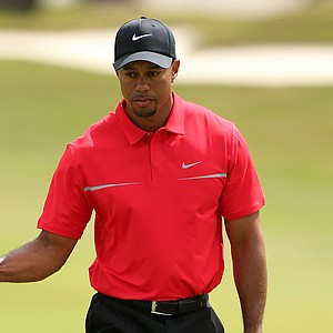 Tiger Woods celebrates his birdie putt on the second hole during the final round of the WGC-Cadillac Championship.