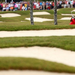 Tiger Woods plays a shot from the rough on the first hole during the final round of the WGC-Cadillac Championship.
