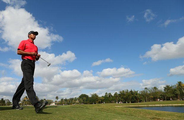 Tiger Woods walks off the ninth tee during the final round of the WGC-Cadillac Championship.