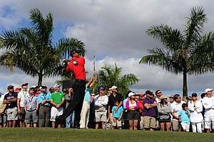 Tiger Woods watches his tee shot on the eighth hole during the final round of the WGC-Cadillac Championship.