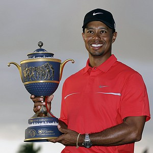 Tiger Woods holds the WGC-Cadillac Championship trophy after Sunday's win in Doral, Fla.