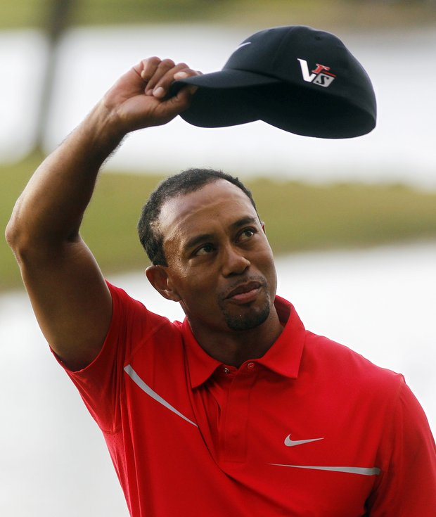 Tiger Woods waves to the gallery Sunday after winning the WGC-Cadillac Championship in Doral, Fla.