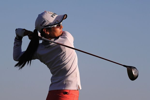 Ai Miyazato hits a tee shot on the 18th hole during the first round of the RR Donnelley LPGA Founders Cup.