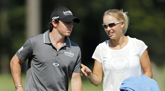 Rory McIlroy and Caroline Wozniacki during the Pro Am round of the Deutsche Bank Championship on Thursday, Aug. 30, 2012, at TPC Boston in Norton, Mass.