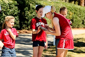 Alabama's Stephanie Meadow stops to sign autographs as she makes the turn during the Sun Trust Gator Women's Invite.