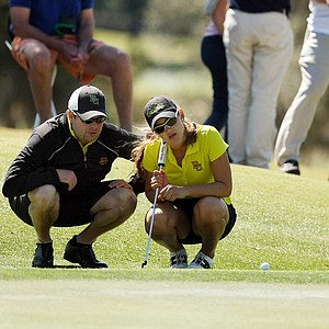 Baylor's head coach Jay Goble with Natalia Perez as they look over Perez's putt at No. 12 during the Sun Trust Gator Women's Invite.