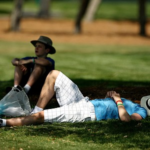Conall McNamara of Dublin rests in the shade on Tuesday of the Arnold Palmer Invitational. He and his family canceled their flight home once they realized the PGA Tour was in town.
