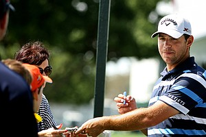 Gary Woodland signs autographs for spectators on Tuesday of the Arnold Palmer Invitational.