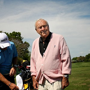 Arnold Palmer looks around the practice range on Tuesday of the Arnold Palmer Invitational at Bay Hill Club and Lodge.