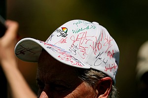 A spectator looks for a few more signatures on Tuesday of the Arnold Palmer Invitational.
