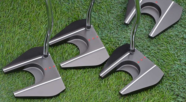 This battalion of Odyssey Tank putters was waiting on the practice green.