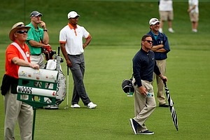 Sean Foley walks with Tiger's Pro-Am group on Wednesday of the Arnold Palmer Invitational.