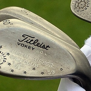 You may have known that Rickie Fowler plays Cobra's AMP Cell Pro irons, but did you know his Titleist Vokey Design Spin Milled wedge proves that he is a vice president of the Justin Bieber Fan Club?