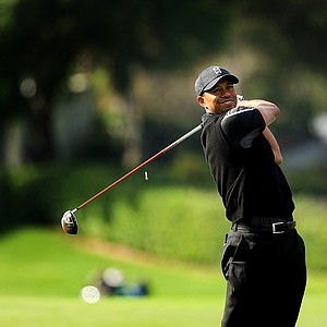 Tiger Woods watches his tee shot at No. 18 in Round 1 of the Arnold Palmer Invitational.