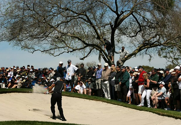 Tiger Woods hits out of the bunker at No. 7 in Round 1 of the Arnold Palmer Invitational.
