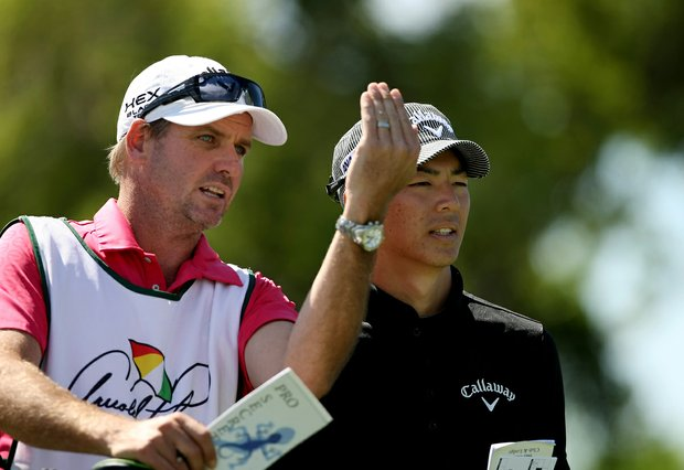 Ryo Ishikawa with his caddie at No. 7 in Round 1 of the Arnold Palmer Invitational.
