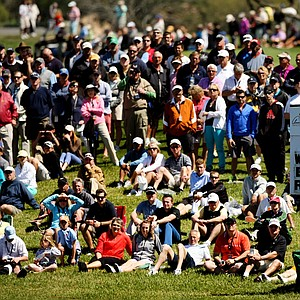 Crowds gather to watch the Tiger Woods group at No. 8 in Round 1 of the Arnold Palmer Invitational.