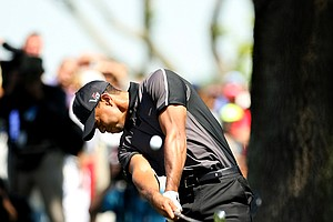 Tiger Woods hits a shot at No. 9 during Round 1 of the Arnold Palmer Invitational.