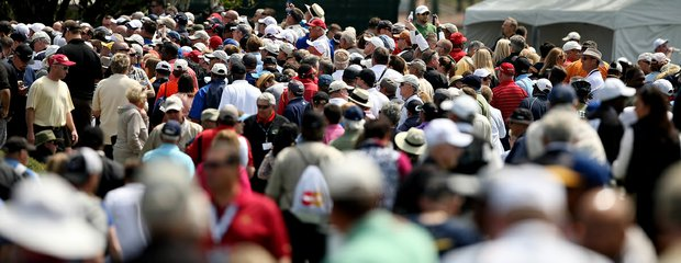 Crowds follow Tiger Woods as he finishes Round 1 of the Arnold Palmer Invitational.