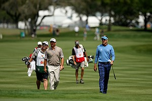 Ian Poulter, right, and Graeme McDowell make their way to nine green in Round 1 of the Arnold Palmer Invitational.