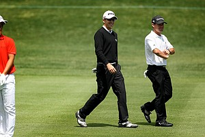 Scott Langley and Brian Harman make their way down the 8th fairway in Round 1 of the Arnold Palmer Invitational.