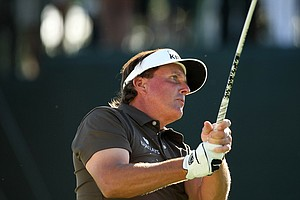 Phil Mickelson hits his tee shot at  No. 18 in Round 1 of the Arnold Palmer Invitational.