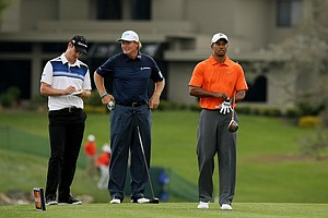Justin Rose, Ernie Els and Tiger Woods wait at No. 16 during Round 2 of the Arnold Palmer Invitational.