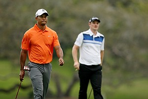Tiger Woods and Justin Rose make their way down No. 16 in Round 2 of the Arnold Palmer Invitational.