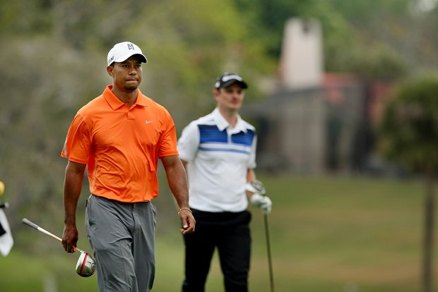 Tiger Woods and Justin Rose make their way down No. 16 in Round 2 of the Arnold Palmer Invitational. Both Rose and Woods posted a 70.