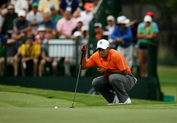Tiger Woods lines up his putt at No. 17 in Round 2 of the Arnold Palmer Invitational.